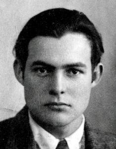 469px-Ernest_Hemingway_1923_passport_photo_TIF.jpg